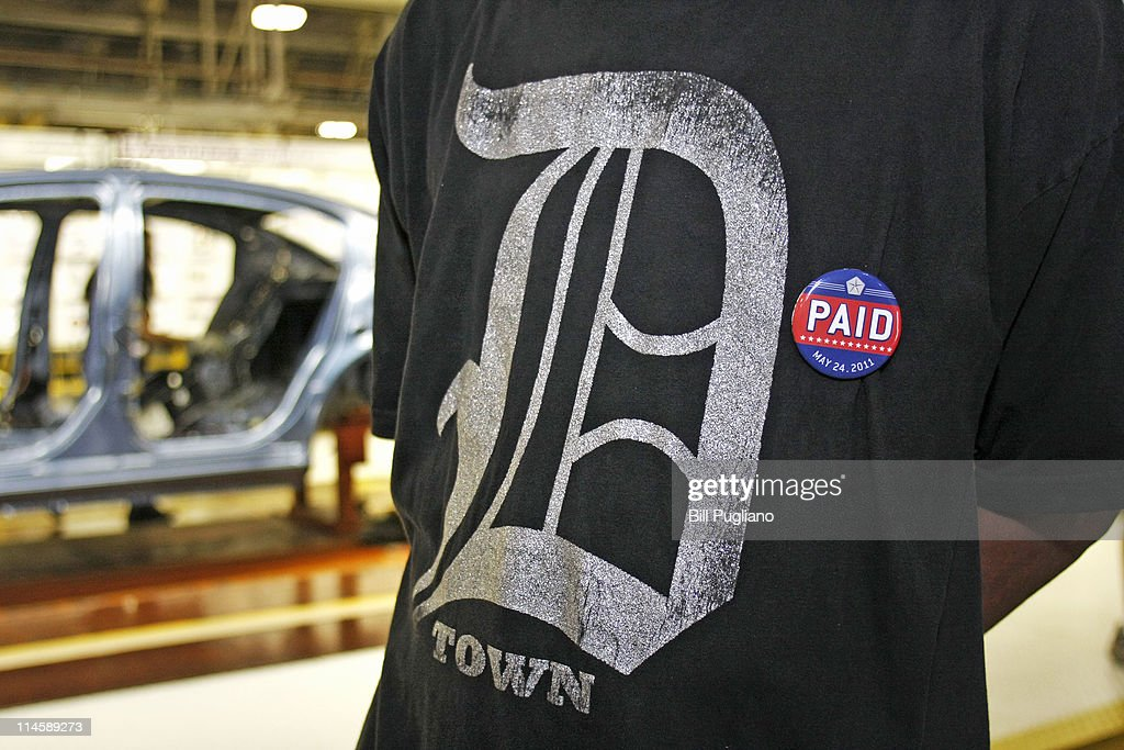An assembly line worker wears a pin labled 'PAID' on his Detroit Tigers shirt before Chrysler Group and Fiat SpA CEO Sergio Marchionne announces the repayment of the remaining $5.9 billion of Chrysler's $10.5 billion loan from the U.S. Government at the Sterling Heights Assembly Plant May 24, 2011 in Sterling Heights, Michigan. Chrysler Group is also retiring a $1.7 billion loan it received from the Canadian government.