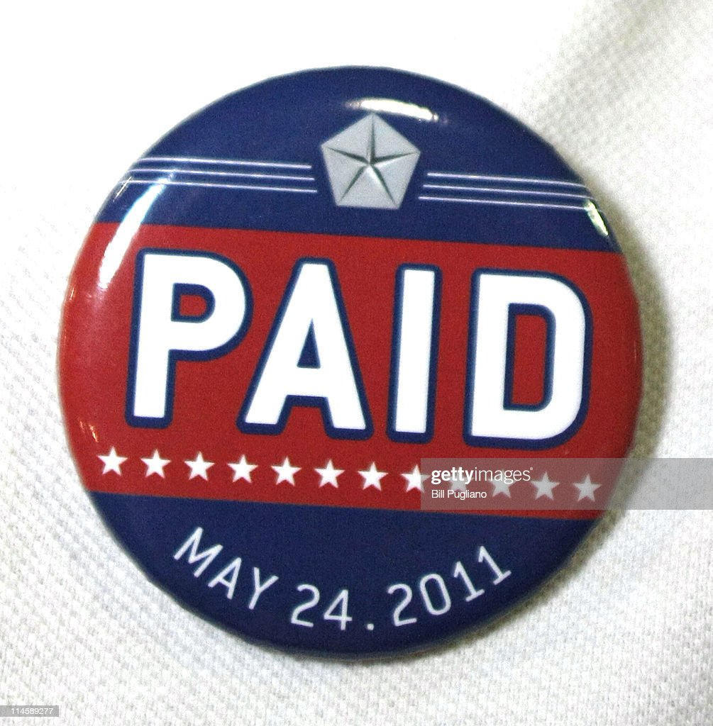 An assembly line worker wears a pin labled 'PAID' on his shirt before Chrysler Group and Fiat SpA CEO Sergio Marchionne announces the repayment of the remaining $5.9 billion of Chrysler's $10.5 billion loan from the U.S. Government at the Sterling Heights Assembly Plant May 24, 2011 in Sterling Heights, Michigan. Chrysler Group is also retiring a $1.7 billion loan it received from the Canadian government.