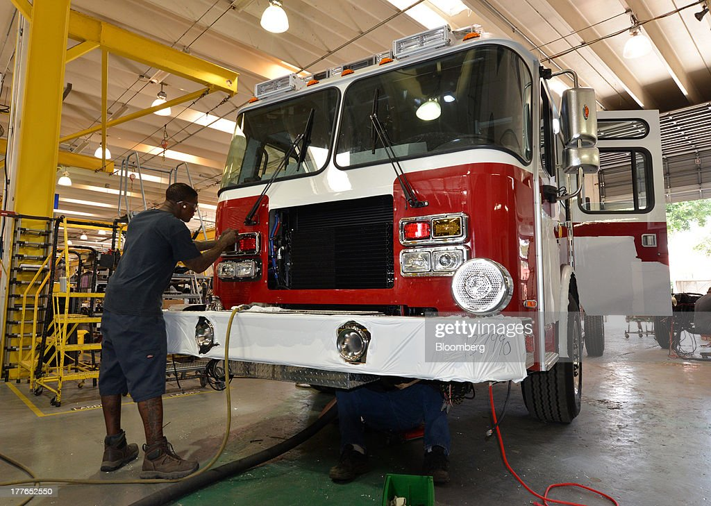 An assembly technician with E-ONE Inc. installs emergency flashers onto a pumper truck at the E-ONE factory, on Tuesday, Aug. 20, 2013, in Ocala, Florida, U.S. The U.S. Census Bureau is scheduled to release durable goods figures on Aug. 26. Photographer: Mark Elias/Bloomberg via Getty Images