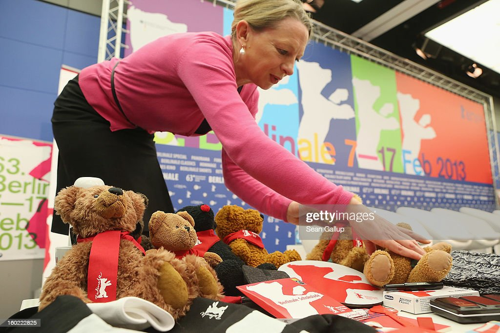An assistant arranges present and past official Berlinale stuffed bears and other merchandising products prior to the opening press conference of the 63rd Berlinale International Film Festival on January 28, 2013 in Berlin, Germany. The 63rd Berlinale will run from February 7-17.