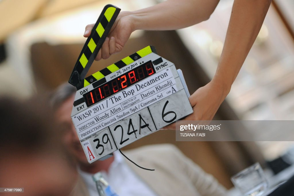 An assistant gets ready withe clapperboard on the set at Piazza della Pace in central Rome during the filming of US film director Woody Allen's new...