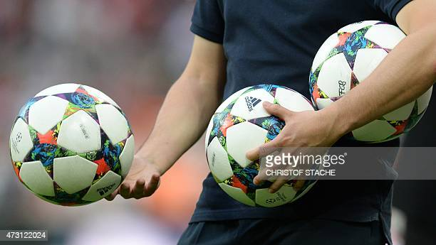 An assistant holds balls prior to the UEFA Champions League semifinal second leg football match FC Bayern Munich vs FC Barcelona in Munich southern...