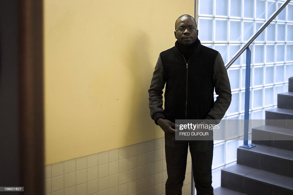 An assistant (APS) in charge of prevention and security patrols in the corridors, at the Maurice Utrillo high school on December 3, 2012 in Stains, northeast of Paris. AFP PHOTO / FRED DUFOUR