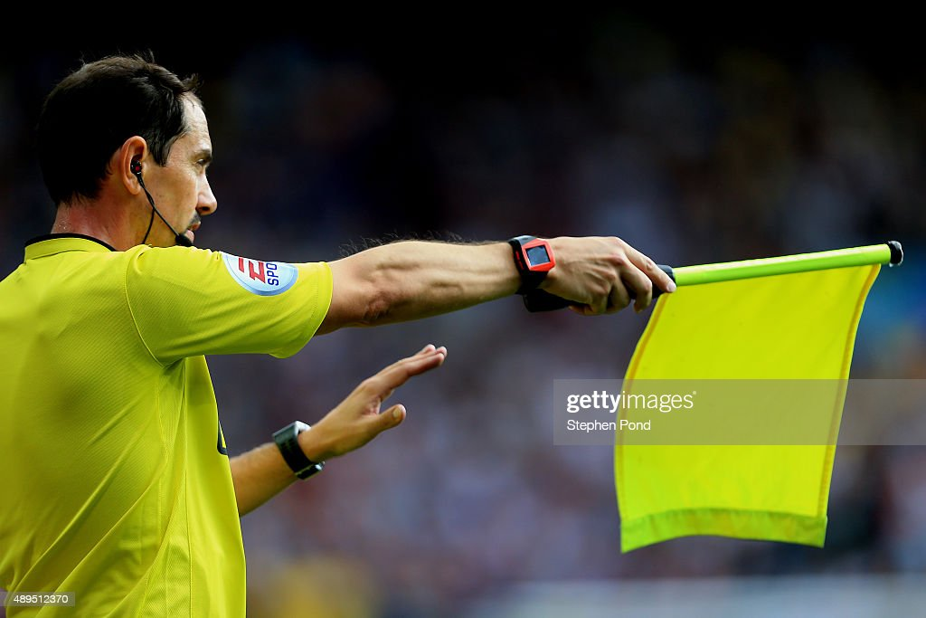 An Assistant Referee holds his flag during the Barclays Premier League match between Aston Villa and West Bromwich Albion at Villa Park stadium on...