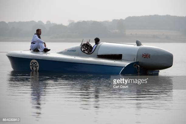 An assistant sits on the deck of the restored Blue Bird K3 hydroplane powerboat as it is towed ahead of a test run at Bewl Water on September 26 2017...