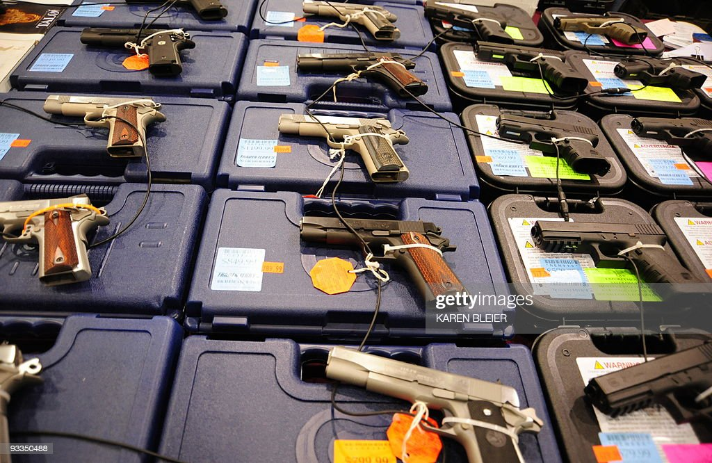 An assortment of Colt and Glock semiautomatic handguns are on display at the Nations Gunshow on November 21 2009 in Chantilly Virginia Vendors and...