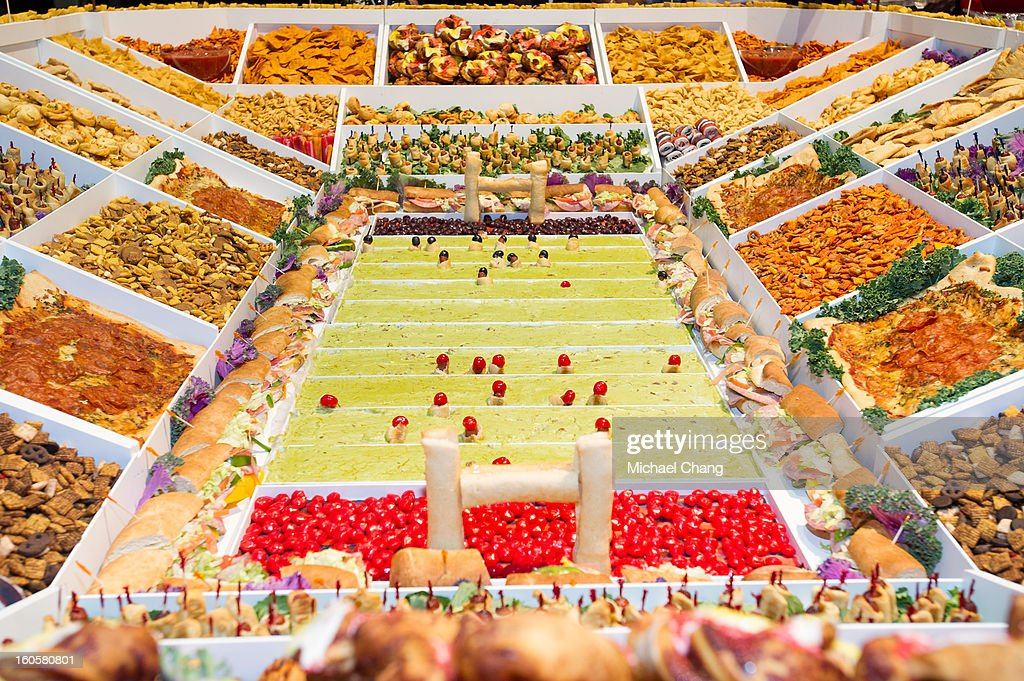 An assortment of foods in the shape of a stadium is displayed during the 2013 Taste of the NFL at the Ernest N. Morial Convention Center on February 2, 2013 in New Orleans, Louisiana.