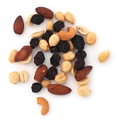 Isolated mixed nuts and raisins on a white background.