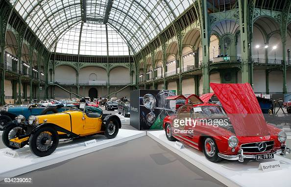 An Aston Martin 15 litre Standard Sports model 1928 and a MercedesBenz 300 SL 'Butterfly' 1955 are displayed during a press preview before a mass...