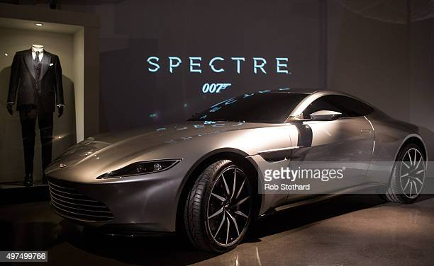 An Aston Martin DB10 produced exclusively for the latest James Bond film Spectre and a James Bond costume are displayed at the London Film Museum on...