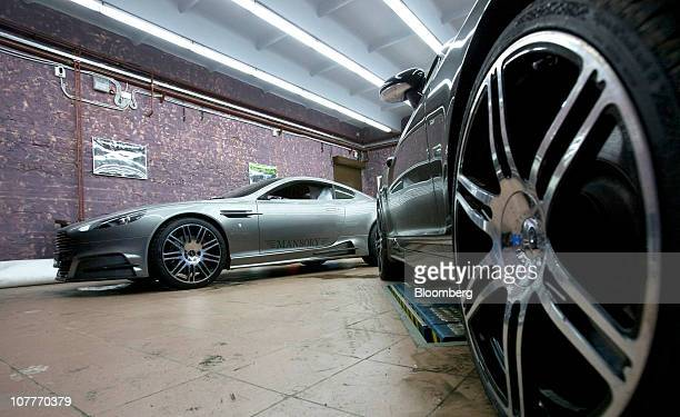 An Aston Martin Lagonda Ltd DB9 vehicle customized by Mansory is seen in the service bay of the newly opened Mansory Switzerland AG showroom in...