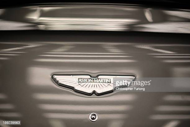 An Aston Martin logo known as the 'Wings' adorns the bonnet of a Vanquish at the company headquarters and production plant on January 10 2013 in...