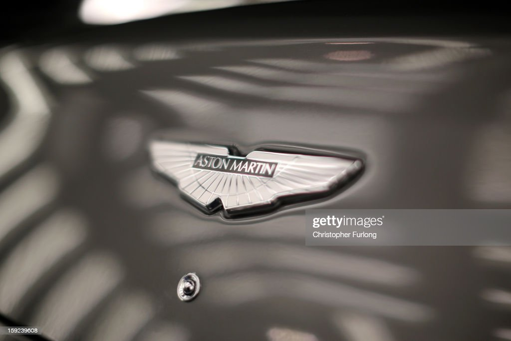 An Aston Martin logo known as the 'Wings' adorns the bonnet of a Vanquish at the company headquarters and production plant on January 10, 2013 in Gaydon, England. The iconic British brand is celebrating its 100th anniversary. Lionel Martin and Robert Bamford created Bamford & Martin on January 15 1913, which later became Aston Martin in honour of Bamford's wins at the Aston Clinton Hillclimb in Buckinghamshire.