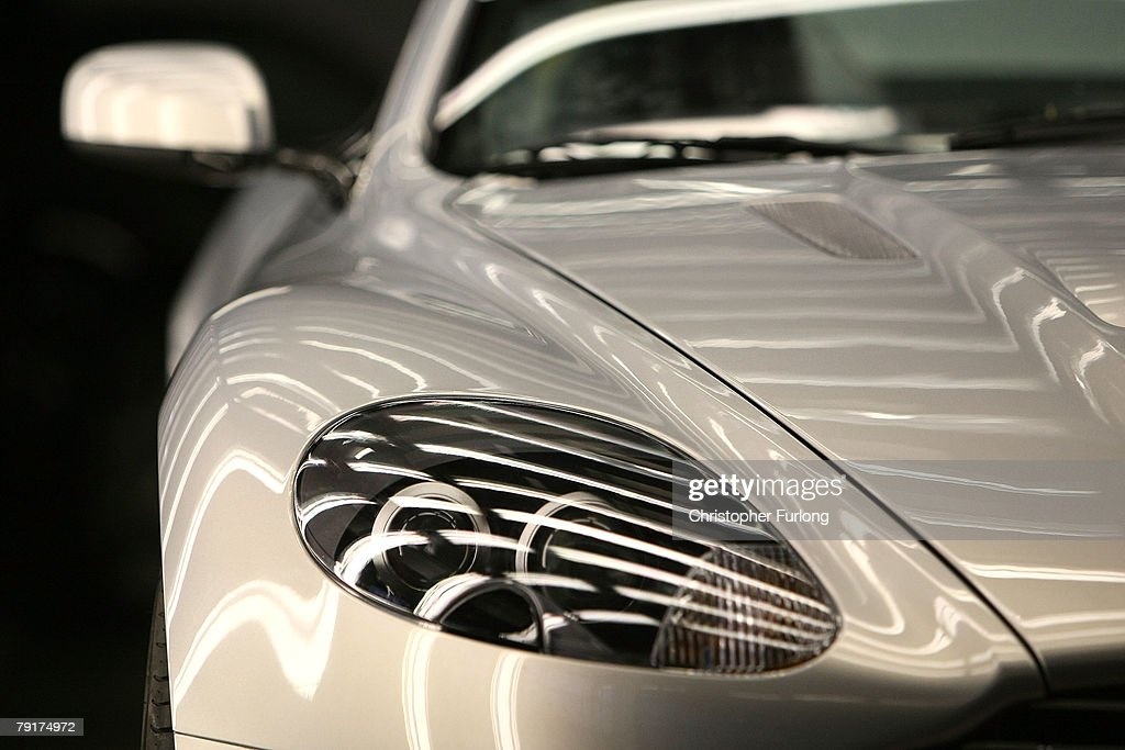 An Aston Martin motor car is checked in a light tunnel during the final inspection at the companies new assembly plant on January 23, 2008 in Gaydon, England. The luxury range of cars which are hand built by craftsmen is seeing growing global demand and is due to open two new showrooms in China due to the brands popularity. In a recent survey Aston Martin was voted the 'coolest' British brand after it's famous association with James Bond.