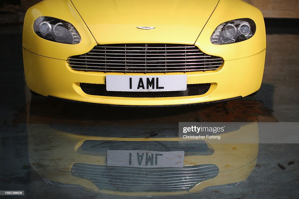 An Aston Martin motor car is displayed outside the company headquarters and production plant on January 10, 2013 in Gaydon, England. The iconic British brand is celebrating its 100th anniversary. Lionel Martin and Robert Bamford created Bamford & Martin on January 15 1913, which later became Aston Martin in honour of Bamford's wins at the Aston Clinton Hillclimb in Buckinghamshire.