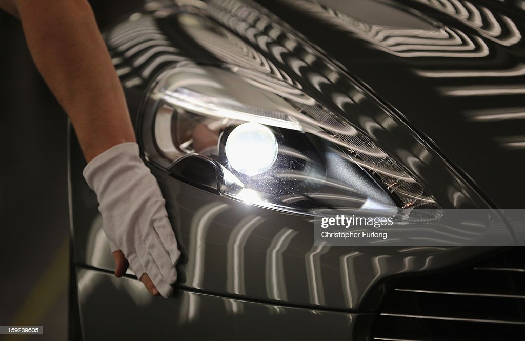 An Aston Martin Vanquish is inspected by hand inside a light booth at the company headquarters and production plant on January 10, 2013 in Gaydon, England. The iconic British brand is celebrating its 100th anniversary. Lionel Martin and Robert Bamford created Bamford & Martin on January 15 1913, which later became Aston Martin in honour of Bamford's wins at the Aston Clinton Hillclimb in Buckinghamshire.