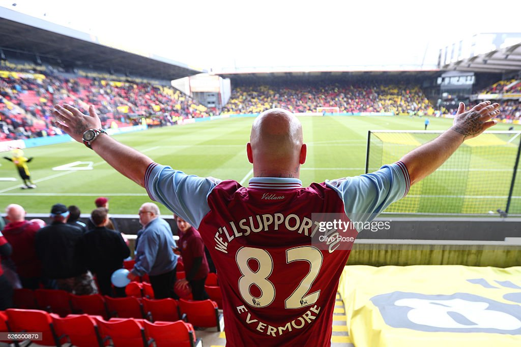 An Aston Villa supporter cheers prior to the Barclays Premier League match between Watford and Aston Villa at Vicarage Road on April 30, 2016 in Watford, England.