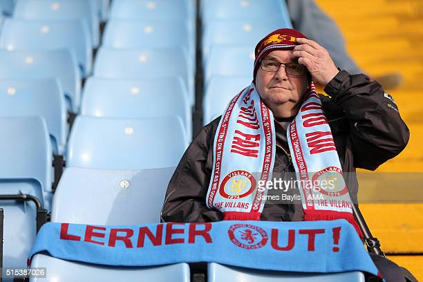 An Aston Villa supporter displays as scarf saying 'Lerner Out' before the Barclays Premier League match between Aston Villa and Tottenham Hotspur at...