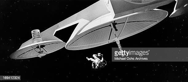An astronaut floats around a space vessel in a scene from the film '2001 A Space Odyssey' 1968