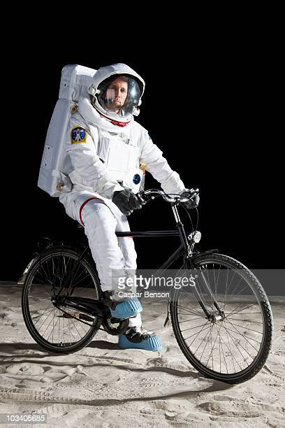 An astronaut on a bicycle on the moon