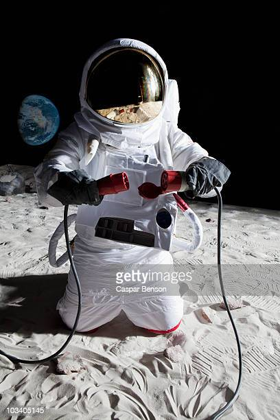An astronaut on the moon connecting two cables