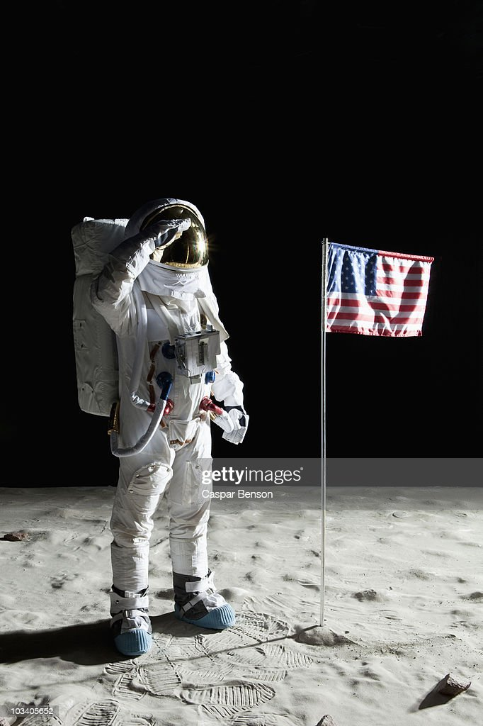 An Astronaut On The Surface Of The Moon Saluting An ...