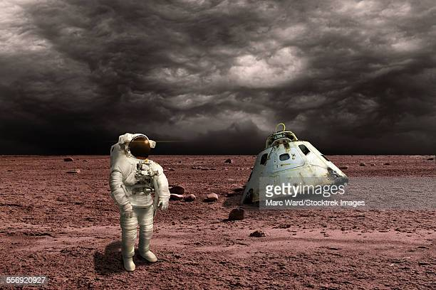 An astronaut surveys his situation after being marooned on a barren planet. Ominous clouds form in the distance while his scorched capsule is nearby.