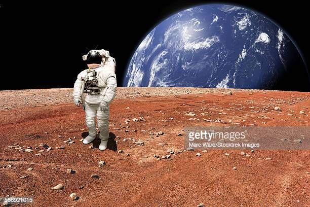 An astronaut surveys his situation after being marooned on a barren planet. A large, water covered world rises above the horizon.