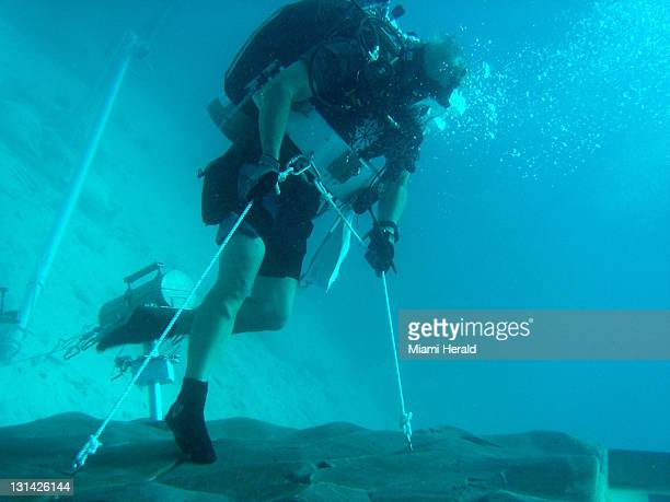 An astronaut works outside the Aquarius habitat in the waters off Key Largo Florida The program part of NASA Extreme Environment Mission Operations...