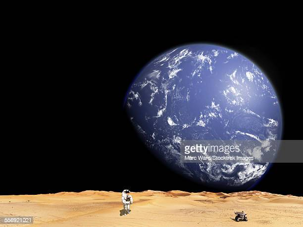 An astronaut works with his rover while exploring a barren moon. A large water covered world rises above the horizon.