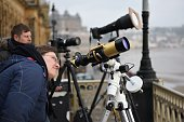 An astronomer checks her telescope before experiencing a partial solar eclipse in Scarborough Northern England on March 20 2015 AFP PHOTO / OLI SCARFF