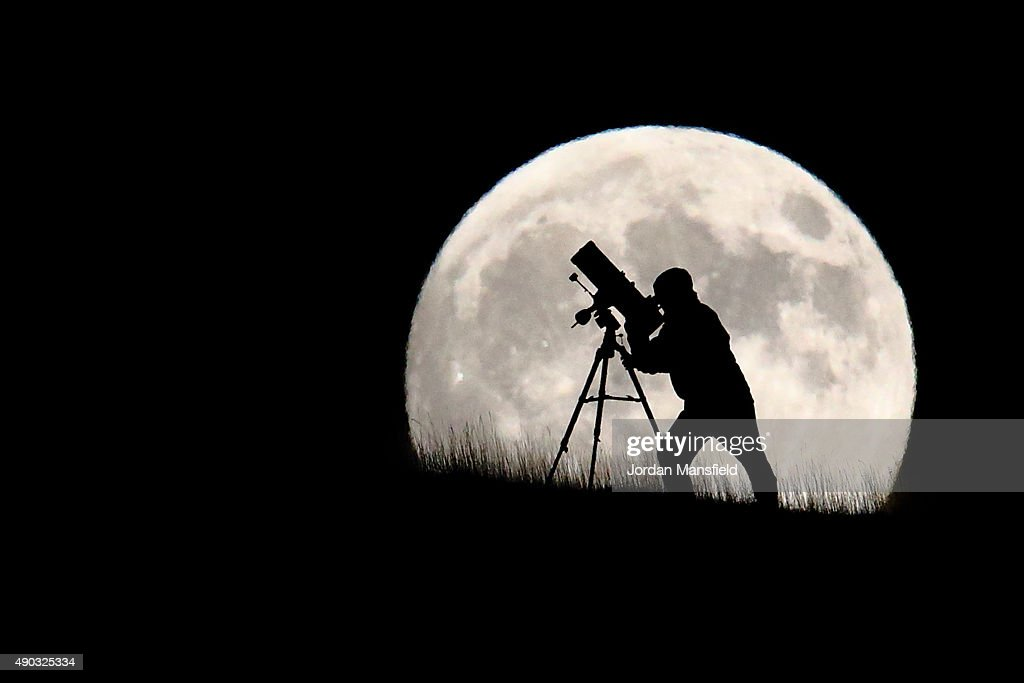 An astronomer stargazes ahead of tonight's supermoon on September 27, 2015 in Brighton, England. Tonight's supermoon, so called because it is the closest full moon to the Earth this year, is particularly rare as it coincides with a lunar eclipse, a combination that has not happened since 1982 and won't happen again until 2033.