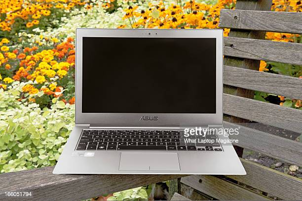 An Asus Zenbook Prime UX31a laptop photographed on a garden bench taken on August 20 2012