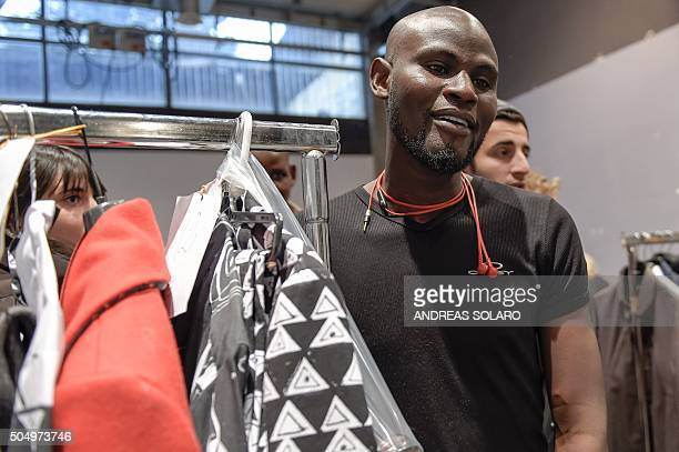 An asylum seeker prepares backstage before taking part in the special event 'Generation Africa' during the ITC Ethical Fashion Initiative as part of...