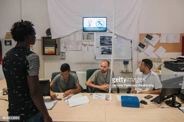 An asylum seeker watches the introductory video that explains the basic laws and rules of the centre and provides them with other useful information...