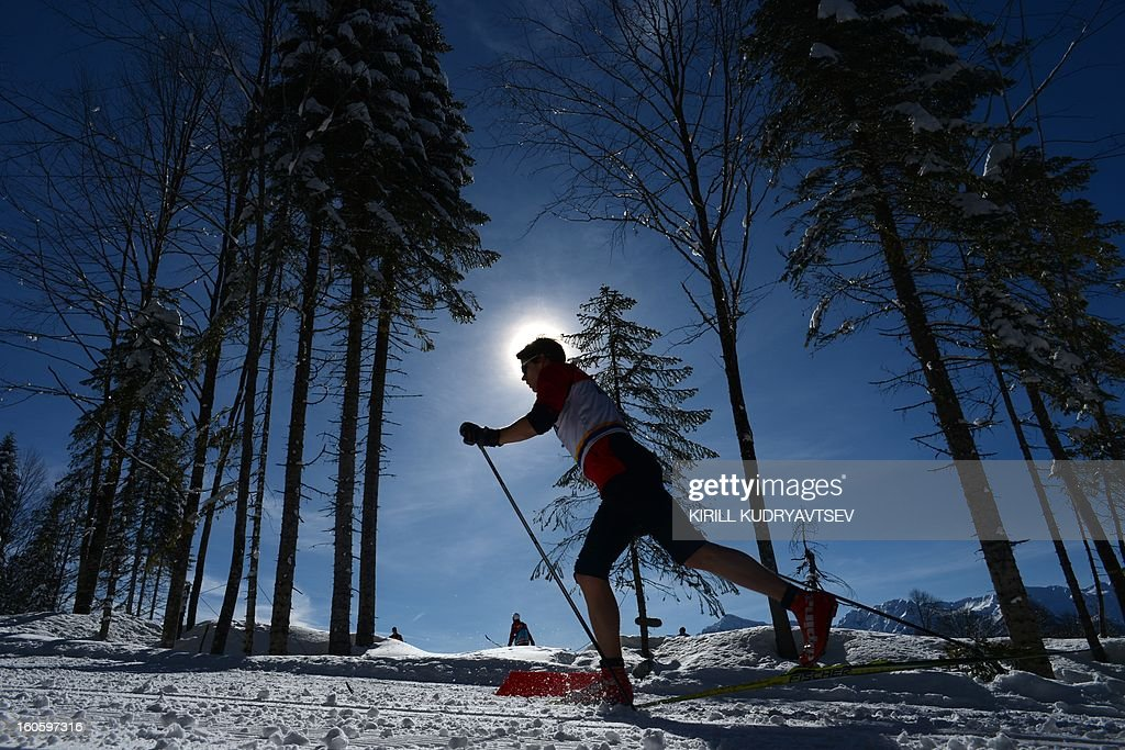 An athlete attends a training session at the Laura Cross Country and Biathlon Center during FIS Cross Country skiing World Cup at in Russian Black Sea resort of Sochi on February 3, 2013.
