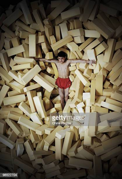 An athlete attends a training session during the 2010 Training Camp For Country's Reserve Gymnastic Athletes at the Gymnastic Hall of Hubei Olympic...