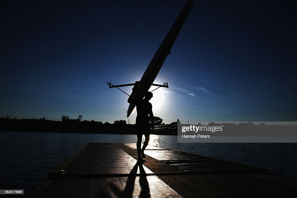 An athlete carries his boat from the water after warming up during day six of the Maadi Cup at Lake Karapiro on March 23, 2013 in Cambridge, New Zealand.