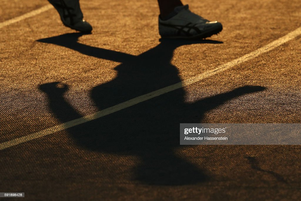 An athlete casts as shadow during the Men's Decathlon Pole Vault on Day 13 of the Rio 2016 Olympic Games at the Olympic Stadium on August 18 2016 in...