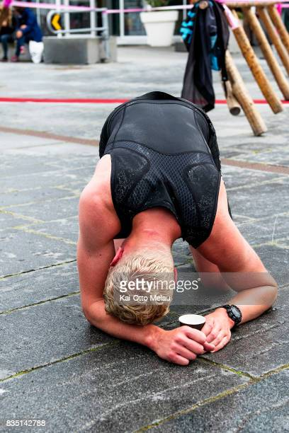 An athlete collapses at the finishline at The Arctic Triple // Lofoten Triathlon Olympic distance on August 18 2017 in Svolvar Norway Lofoten...