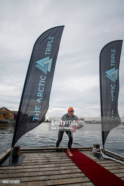 An athlete coming out of the water at The Arctic Triple // Lofoten Triathlon Olympic distance on August 18 2017 in Svolvar Norway Lofoten Triathlon...