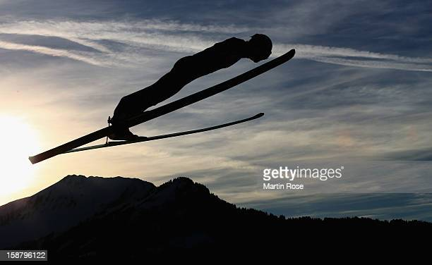 An athlete competes during the qualification round for the FIS Ski Jumping World Cup event of the 61th Four Hills ski jumping tournament at Erdinger...