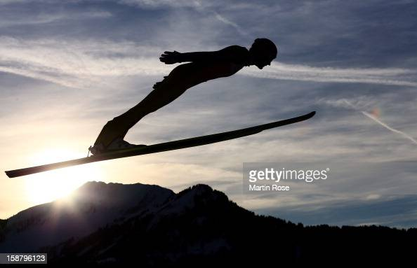 An athlete competes during the qualifikation round for the FIS Ski Jumping World Cup event of the 61th Four Hills ski jumping tournament at Erdinger...
