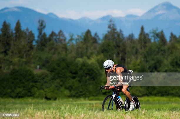 An athlete competes in the bike leg of the race during Ironman Klagenfurt on June 28 2015 in Klagenfurt Austria