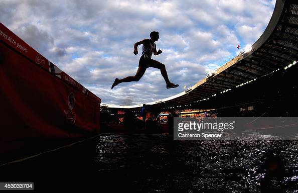 An athlete competes in the Men's 3000 metres Steeplechase final at Hampden Park during day nine of the Glasgow 2014 Commonwealth Games on August 1...