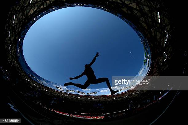 An athlete competes in the Men's Decathlon Long Jump during day seven of the 15th IAAF World Athletics Championships Beijing 2015 at Beijing National...