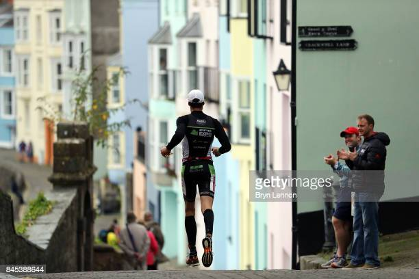 An athlete competes in the run leg of IRONMAN Wales on September 10 2017 in Tenby Wales