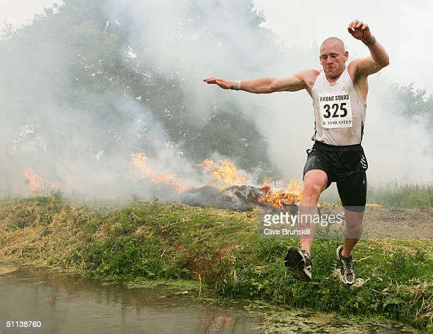 An athlete competes in the Tough Guy 2004 competition dubbed 'Nettle Warrior VII Year of the Jungle Fighter' on July 25 2004 in Perton Staffordshire...