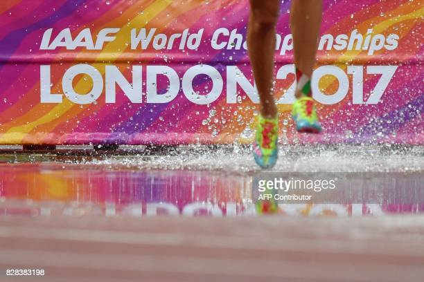 TOPSHOT An athlete competes in the women's 3000m steeplechase athletics event at the 2017 IAAF World Championships at the London Stadium in London on...