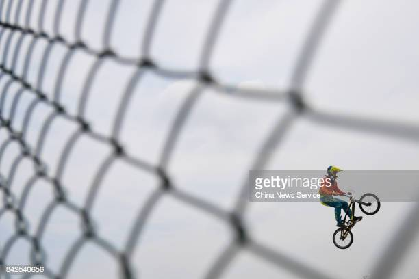 An athlete competes in the Women's BMX cycling event of the 13th Chinese National Games at Tianjin Tuanbo sport center on September 4 2017 in Tianjin...